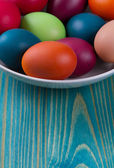 Easter eggs in the blue  wooden background — Stock Photo