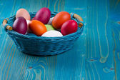 Easter basket with color eggs — Stock Photo