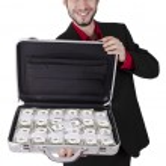 Businessman full of cash — Stock Photo