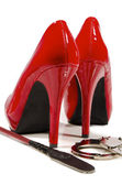 High heels and riding crop — Stock Photo