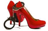 Handcuffs and high heels — Stock Photo