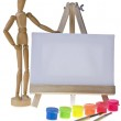 Canvas,brushes and easel — Stock Photo #18690353