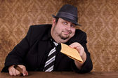 Gangster holding brown envelope — Stock Photo