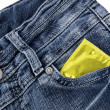 Condom in a jeans pocket — Stock Photo