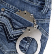 Handcuffs in the pocket — Stock Photo