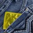 Condom in a jeans pocket — Photo