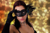 Beautiful young woman in carnival mask — Foto de Stock