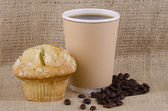 Coffee and lemon poppy seed muffin — Stock Photo