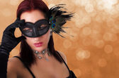 Beautiful woman in carnival mask. — Stock Photo
