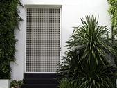 White wall entrance with garden — Stock Photo