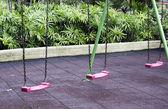 Pink garden swing — Stock Photo