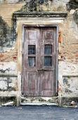 Old door of brick building — Stock Photo