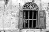 Old style wall and widow, black and white — Stock Photo