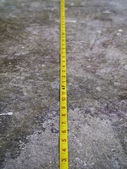 Measuring Tape on Concrete Floo — Stock Photo