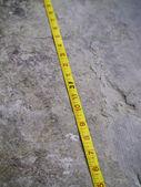 Construction Measuring Tape on grunge concrete — Stock Photo