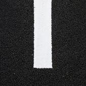 Asphalt texture with white line — Stock Photo