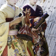 Stock Photo: Geishas walking by an old street