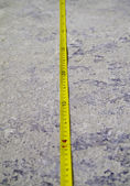Construction Measuring Tape on concrete floor — Stock Photo