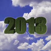 2013 new year with grunge wall and old wood floor — Stock Photo