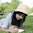 Stock Photo: Beautiful teenage girl writting book