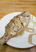 Fried fish on white dish — Stock Photo