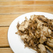 Asian style fried pork on dish — Zdjęcie stockowe