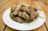 Fried fish on white dish and wood backgroun — Stock Photo