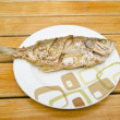 Fried fish on  wood background — Stok fotoğraf