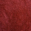 Red carpet texture, close-up - Stock Photo
