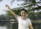 Happy woman smiling carefree and joyful in park — Stock Photo