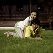 Couple lie on ground in park relaxing — Stock Photo #21855257