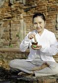 Woman playing a tibetan bowl — Stock Photo