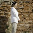 Buddhist woman standing meditating — Stock Photo #22856316