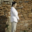 Buddhist woman standing meditating - Stok fotoraf