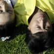 Seniors couple lying on grass — Stock Photo