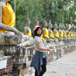 Stock Photo: Beautiful asiwomand buddhat Wat Yai Chai Mongkol Temple