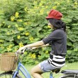 Young woman cycling and having fun — Stock Photo