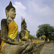 "Buddha statues in a row at ""Wat Yai-Chaimongkol temple in Ayutth - Stock Photo"