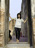Asian woman enjoying at Buddhist temple in Thailand. — Stock Photo