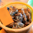 Crabs in basket for sale, seafood markets - Stock Photo