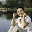 Beautiful asian woman listening music — Stock Photo