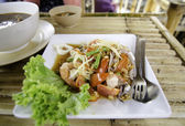 Thai Papaya Salad hot and spicy with seafood. — Stock Photo