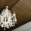 Crystal chandelier hang on wood ceiling — Stock Photo