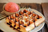 Waffle with scoop of strawberry sherbet ice cream — Stock Photo