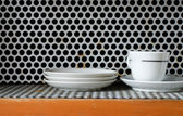 Clean plates and cups on grunge metal Grill Pattern — Stock Photo