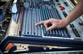 Sound engineer works with sound mixer — Stock Photo