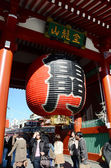 TOKYO, JAPAN - NOV 21: Imposing Buddhist structure features a massive paper lantern painted — Stock Photo