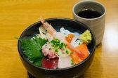 Japanese style raw seafood (sashimi) with rice — Stock Photo