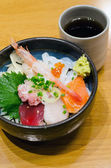 Japanese style raw seafood (sashimi) rice — Stock Photo