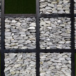 Modern art wall grass and stone — Stock Photo
